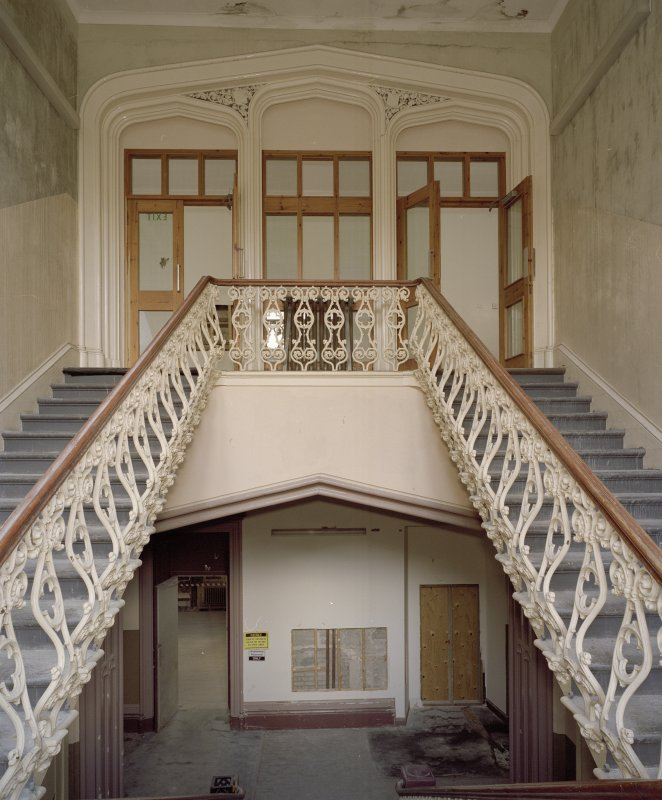 Interior. Main staircase, view from half landing to N