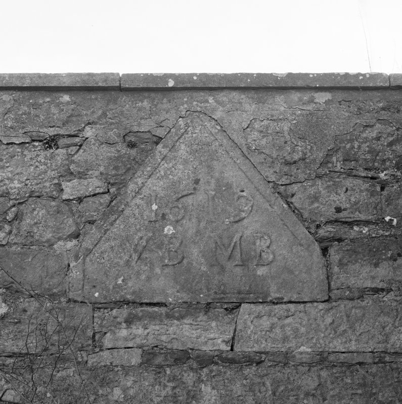Detail of reser dormer head dated 1619 with initials WB MB