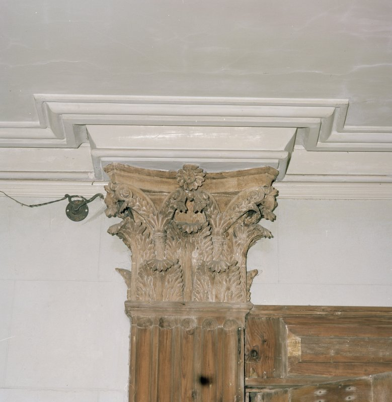 Interior. Ground floor. Hall. Detail of Corinthian door capital.