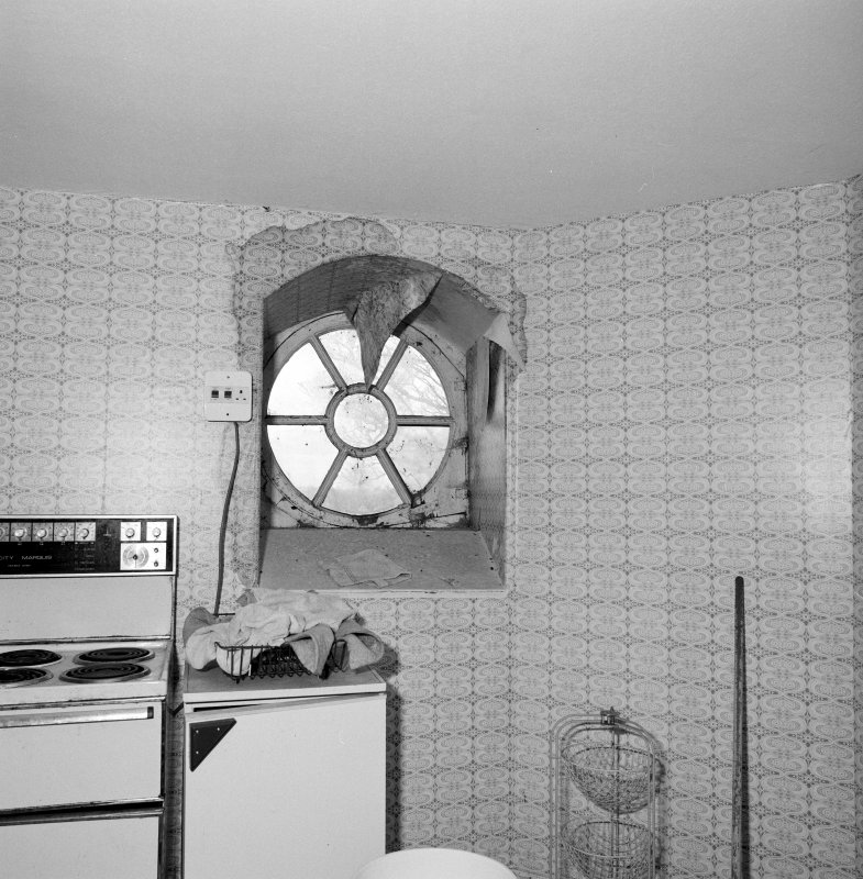 Interior. Attic. Kitchen. Detail of round window.