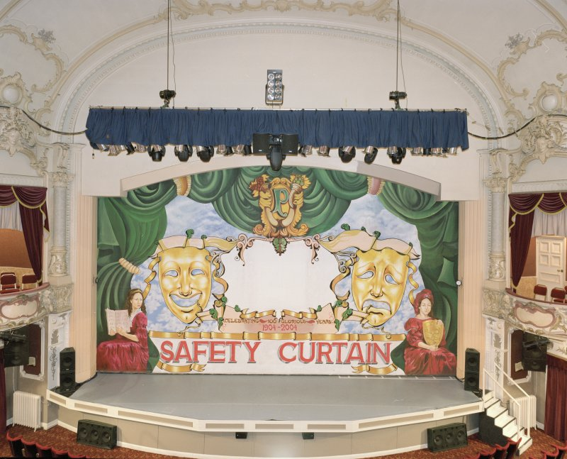 Interior.  Auditorium, view of stage from circle to N (safety curtain (iron) down)