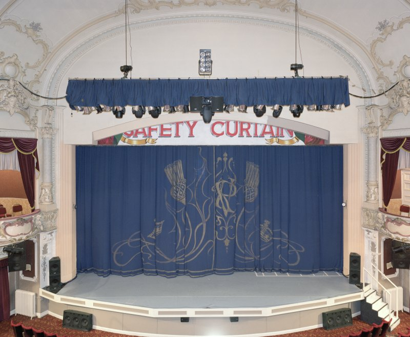 Interior.  Auditorium, view of stage from circle to N (tabs down)