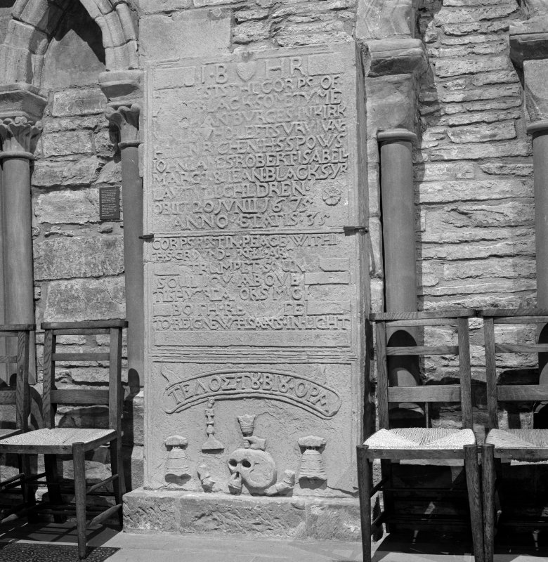 Interior.  Nave, view of carved grave slab
