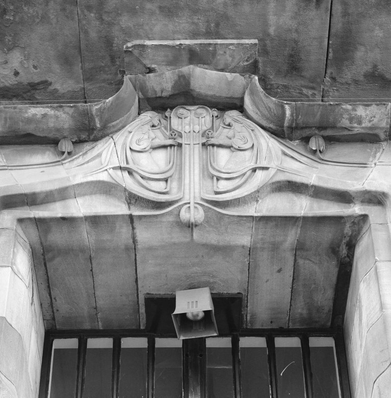 View of N facade, main doorway, detail of carved panel above doorway, Glasgow School of Art.