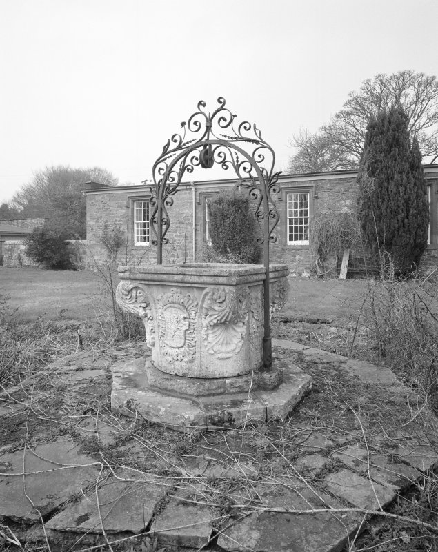 View of well and wrought iron wellhead