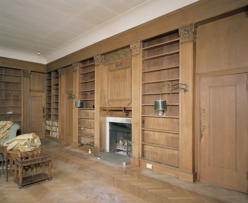 Interior. Ground floor library in W wing showing fitted pilastered bookcases