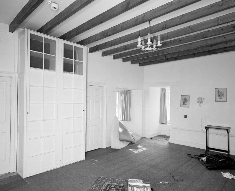 Interior. Second floor bedroom showing fitted cupboards