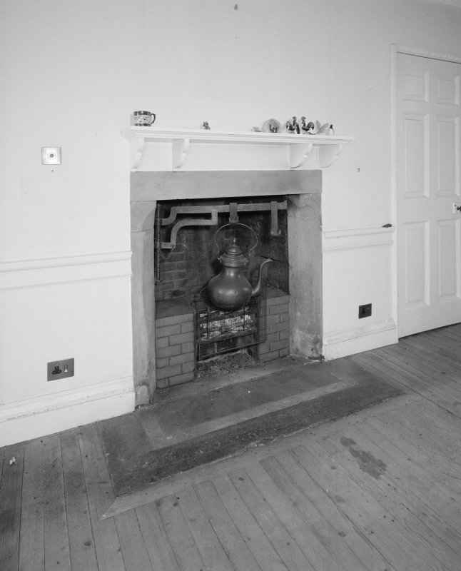 Interior. First floor drawing room detail of fireplace