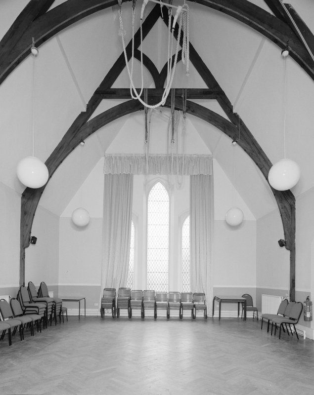 Interior. First floor hall with original gymnastics ropes