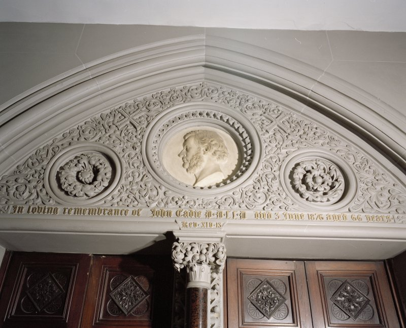 Interior. W lobby, detail of tympanum with portrait  medallion of Rev John Eadie by John Mossman 1876