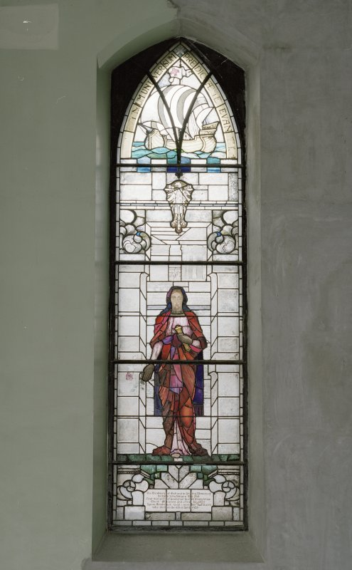 Interior. N wall  stained glass window c.1929 memorial to Rev John Wilson