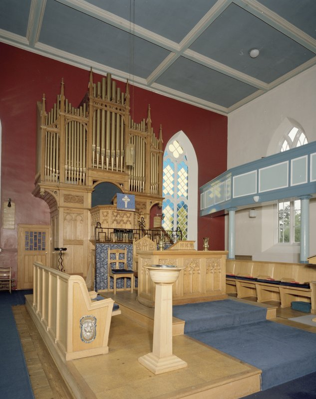 Interior. View ofplatform showing organ, communion table, font and eler's seats
