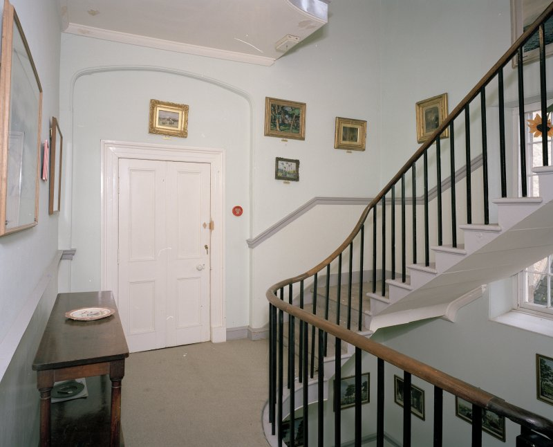 Interior. First floor. Stair hall with linking door to castle
