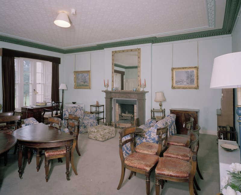 Interior. First floor. Drawing room showing fireplace (dining table and chairs not originally in the room)