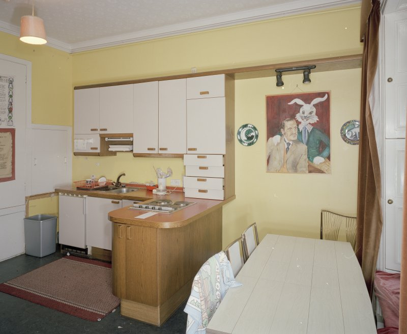 Interior. First floor. Private or family kitchen with 1970's units showing dining area and portrait of Ninian Brodie of Brodie