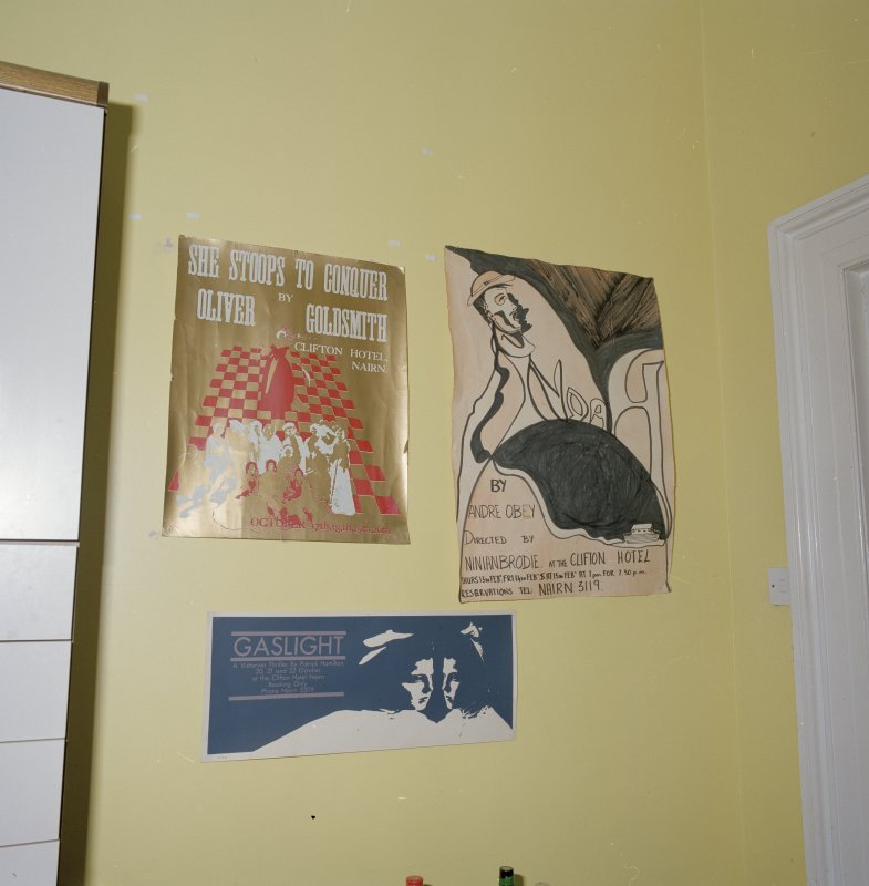 Interior. First floor. Private or family kitchen. Detail of theatrical posters