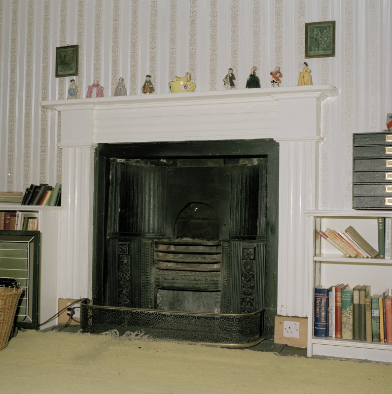 Interior.  First floor Upper level suite. Study. Detail of fireplace with register grate