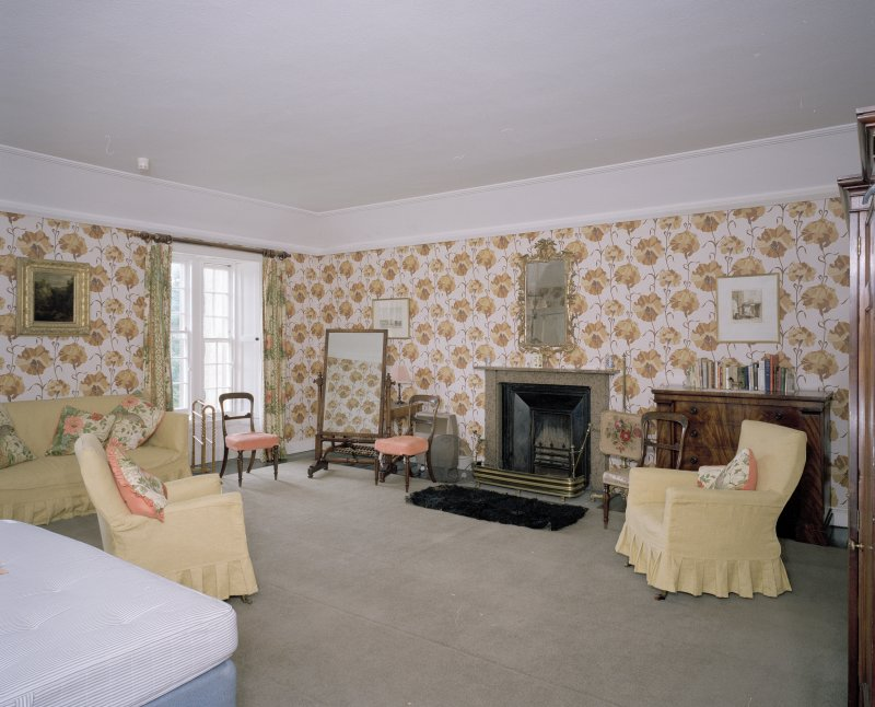 Interior.  Second floor. Principal guest bedroom with dramatic floral wallpaper.