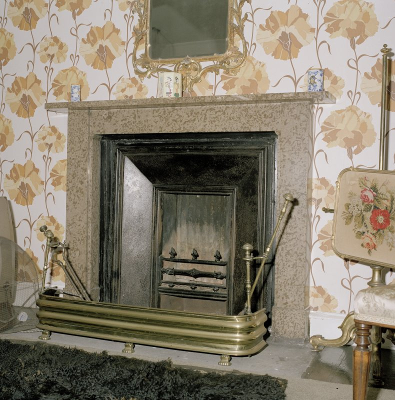Interior.  Second floor. Principal guest bedroom. Detail of fireplace