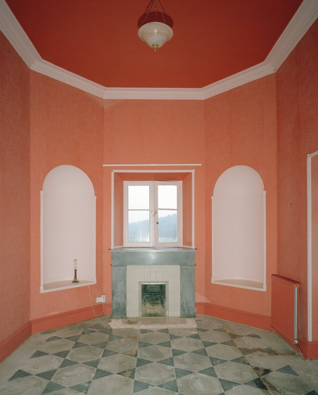 Interior. Ground floor S octagonal entrance hall showing fireplace beneath the window and flanking niches