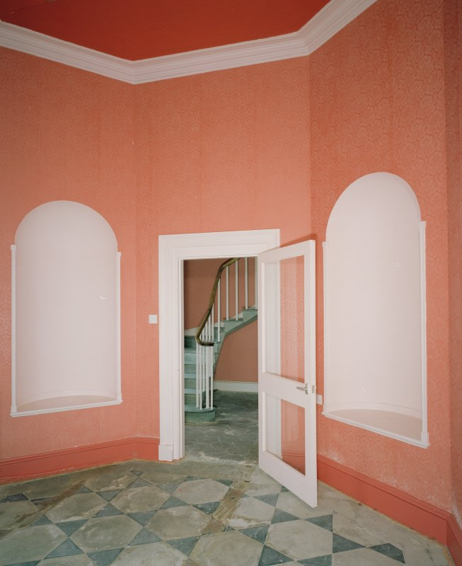 Interior. Ground floor S octagonal entrance hall showing door to stairhall and flanking niches