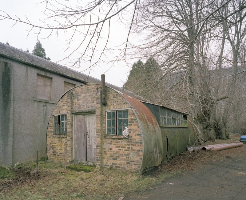 Garages/Workshops and nissen hut. View from ESE