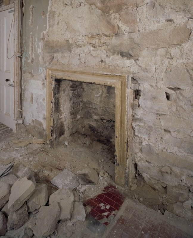 Interior. N range, ground floor, W room W wall detail of roll moulded fireplace