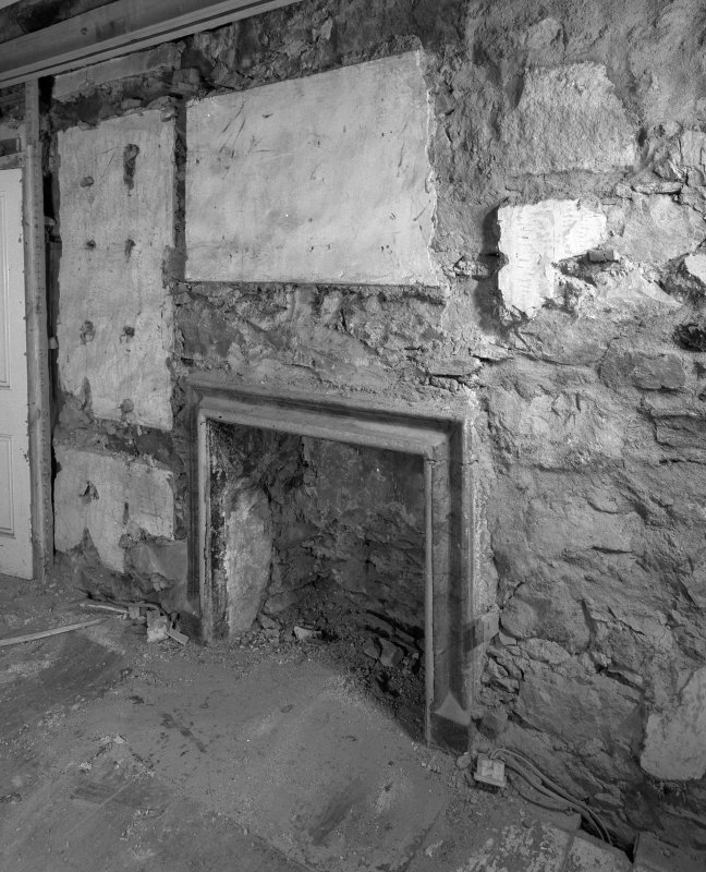 Interior. N range, first floor W room W wall detail of fireplace