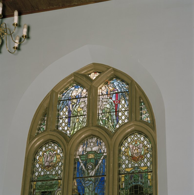 Interior. Chancel stained glass window of the cruxifiction by Douglas Strachan 1924