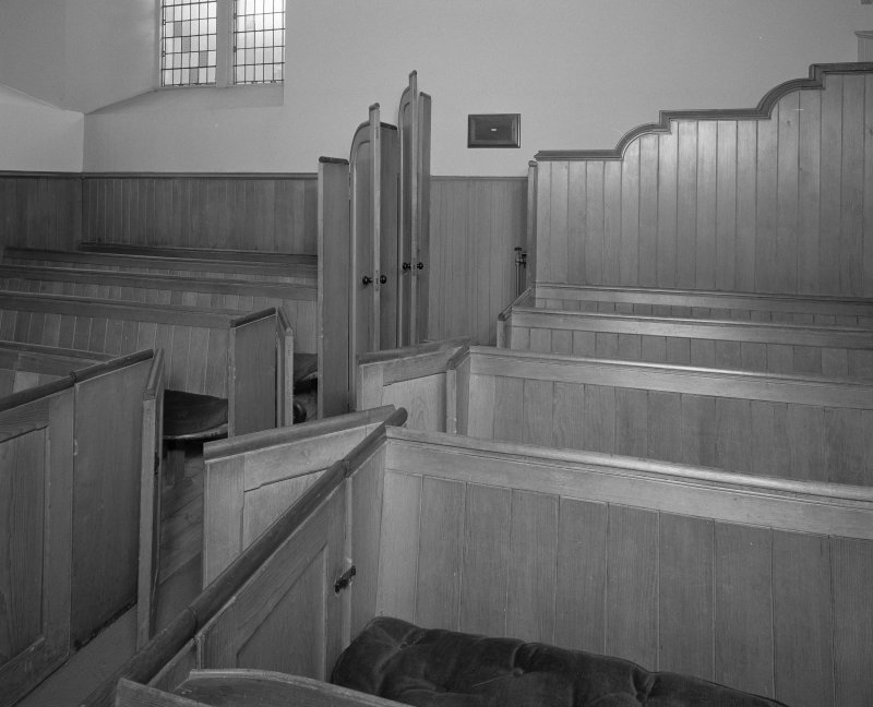 Interior. View of pews, doors open