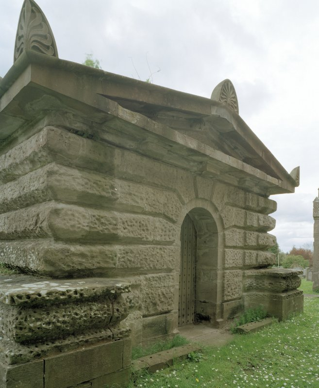 Oblique view of Mausoleum frontage from NE showing pediment and decorative stone work