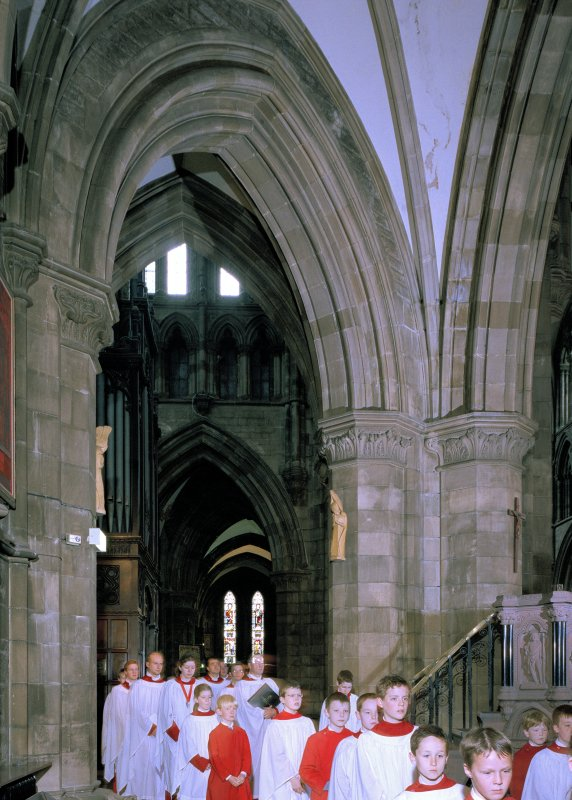 Interior. View of aisle showing choiristers' procession passing by crossing area.