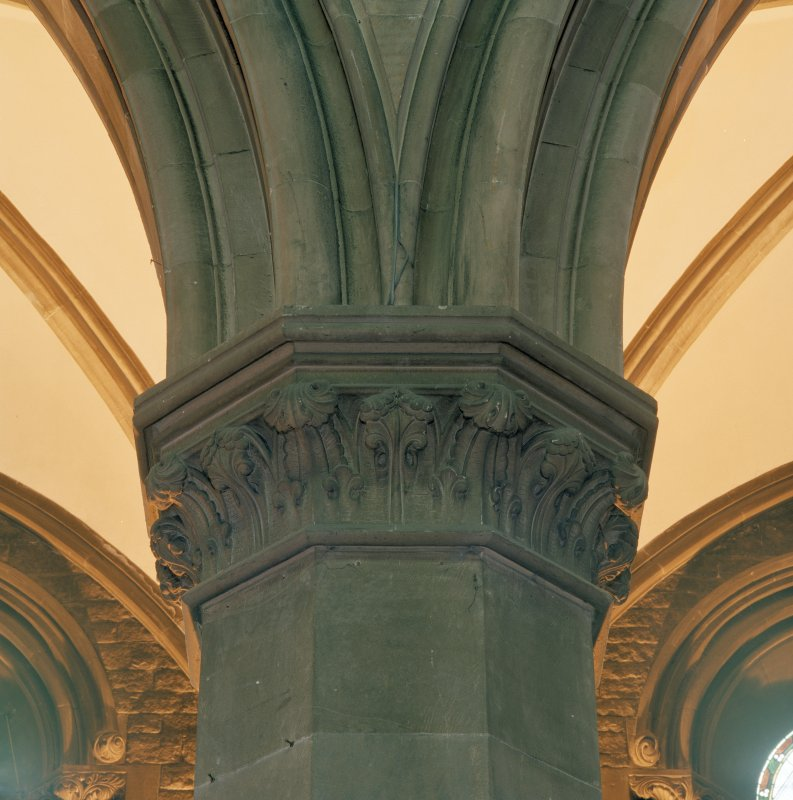 Interior. Detail of masonry column showing upper shaft, capital with stylized foliage, and springing of arch ribs.