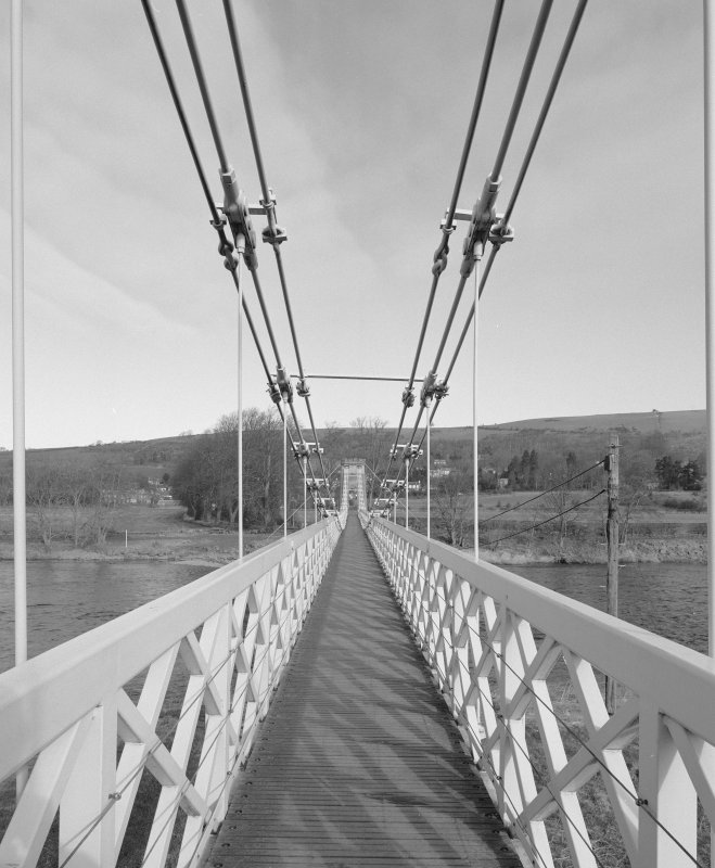 View across deck of bridge showing suspension from S