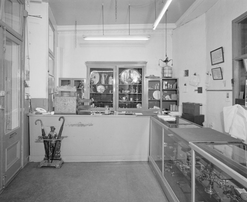 Interior. Ground floor. View of front shop from SW