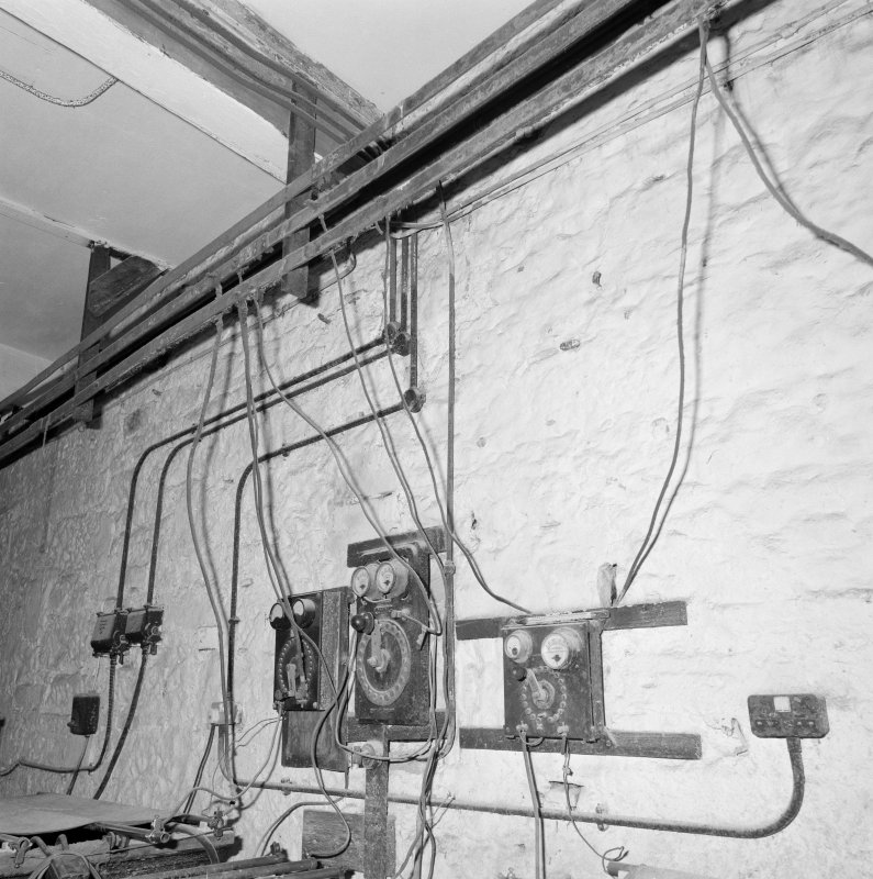 Interior. Lower ground floor. Workshop. Detail of control switches and overhead busbar
