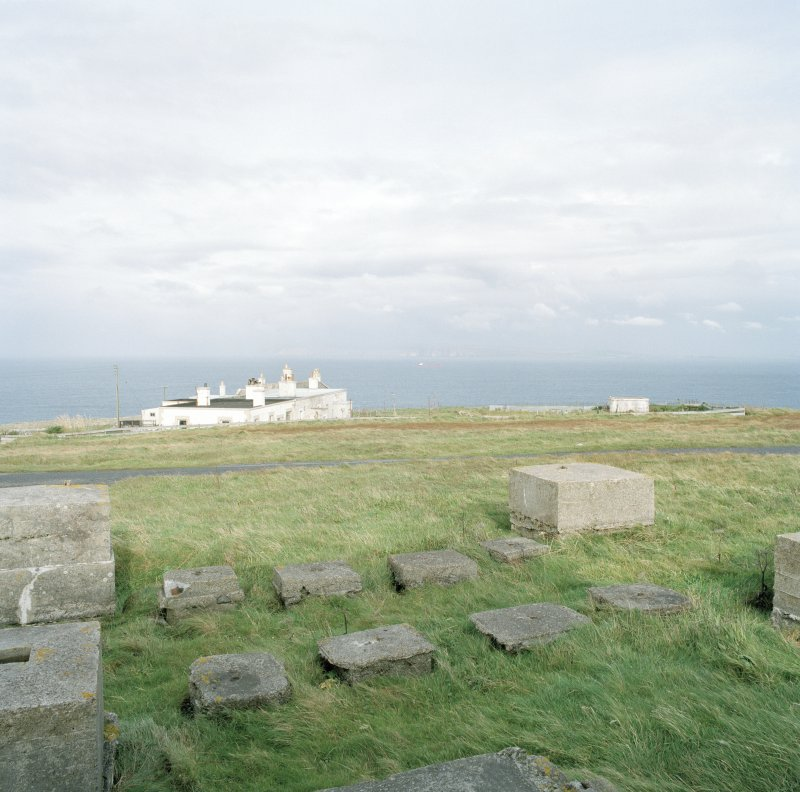 View from S of group of mast bases at the N end of the transmitter receiver block. Also visible is the Dunnet Lighthouse keeper's cottage.