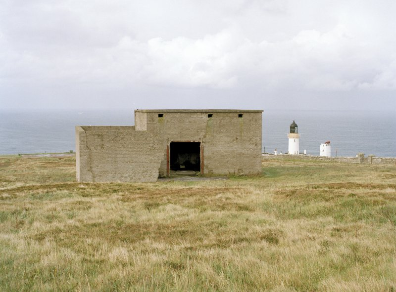 View from SE of engine room with blast wall. Also visible is Dunnet head lighthouse.