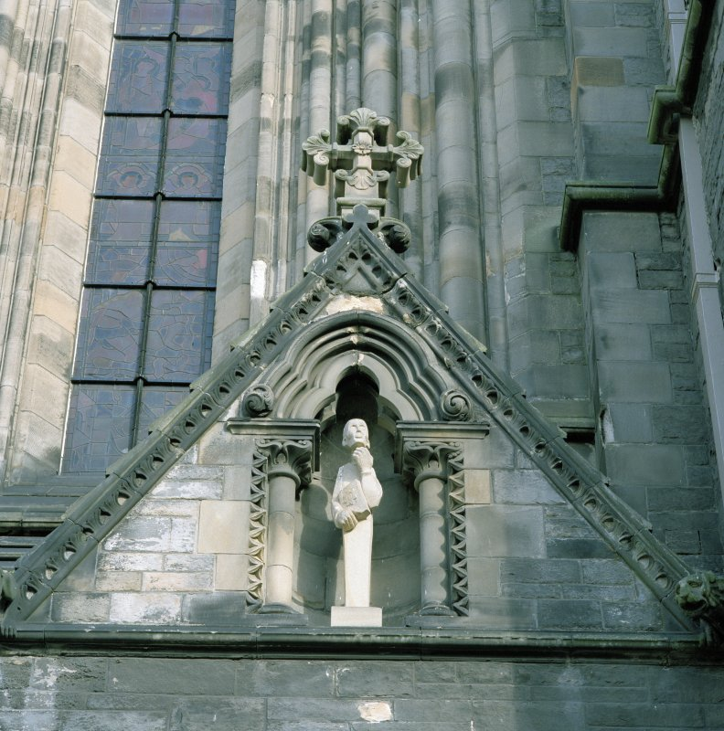 Detail of main entrance in SW elevation showing right hand gable with niche and modern sculpture bust.
