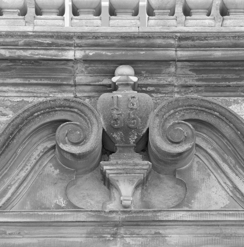 Detail of 1855 dated pediment over E entrance