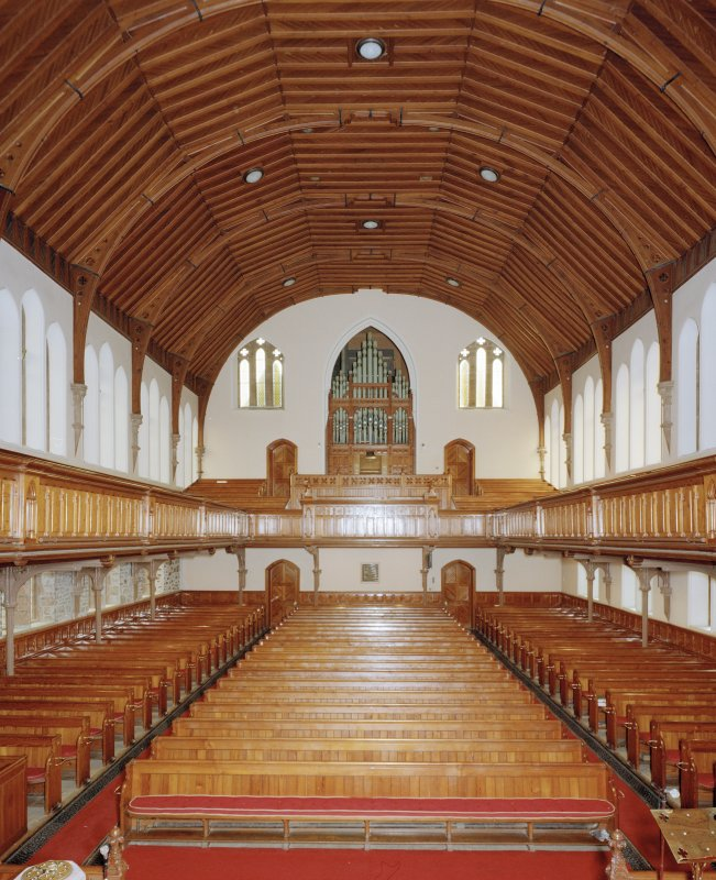 Interior. View from W showing gallery and organ.