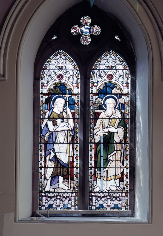 Interior. Detail of stained glass window of St John by Ballantine.