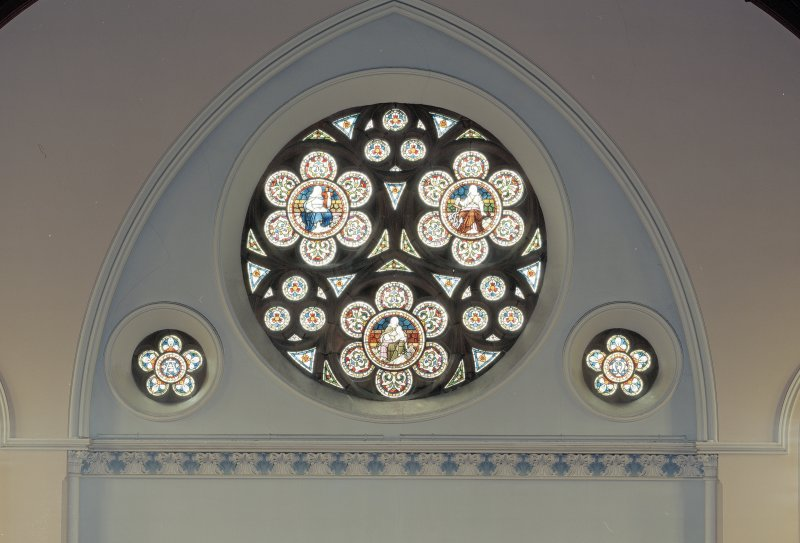 Interior. Detail of W Rose window designed by William Starforth  executed by James Ballantine & Son 1887.