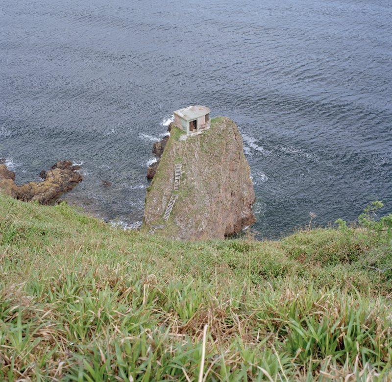 General view from SW over cliffs to searchlight emplacement on rock stack.  Also visible are sections of timber access steps.