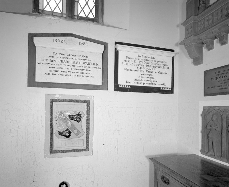 Interior, entrance lobby, detail of memorial plaques to past ministers and sculpyural fragment