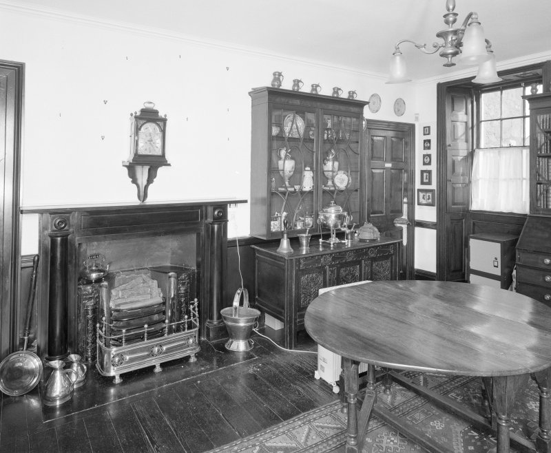 Interior, view of ground floor hall from North West showing black marble fireplace c.1820