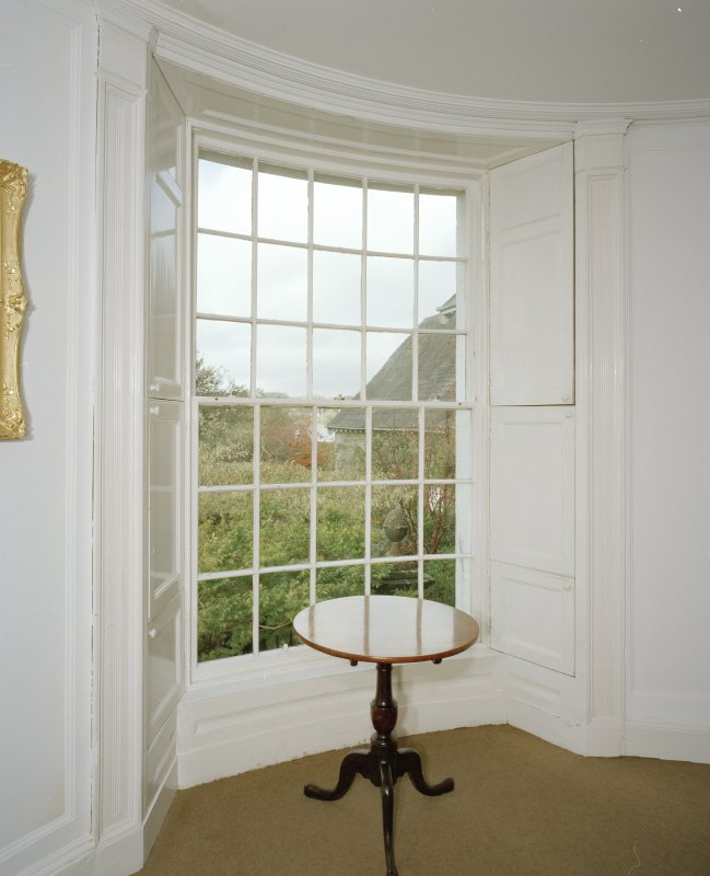 Interior, detail of dining room curved sash window