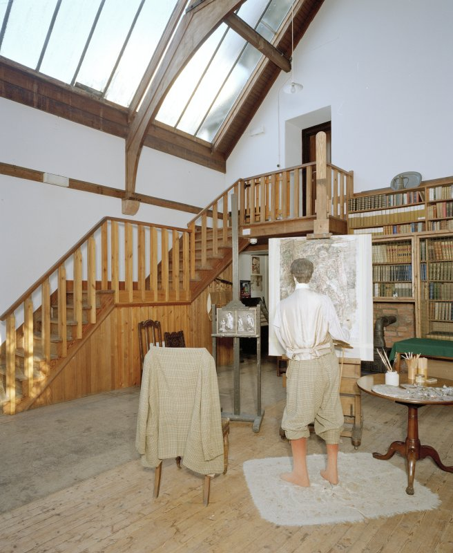 Interior, view of studio from West Interior, showing bookcases, entrance staircase and manequin representing Hornel at work