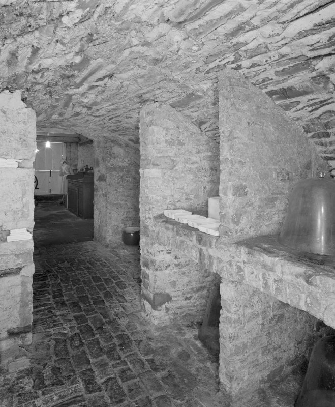 Interior, view of lower ground floor vaulted wine cellar with bins