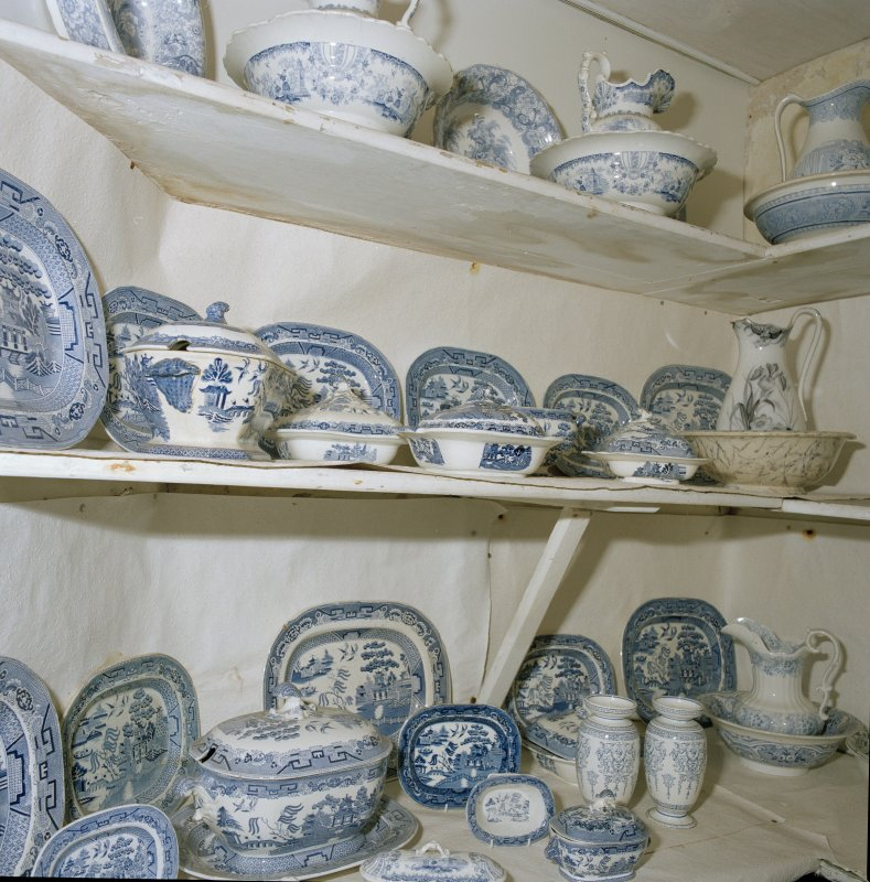 Interior, detail of lower ground floor china cupboard blue and white china